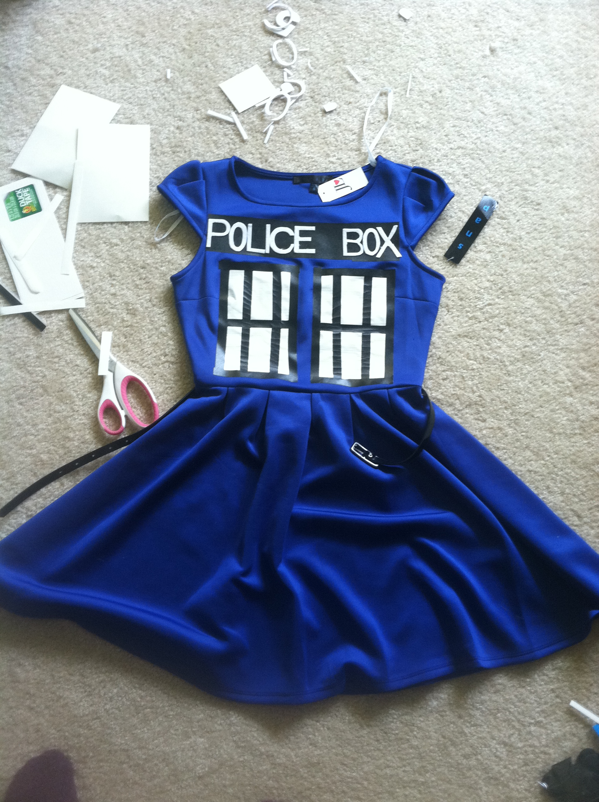 Remove the backing and place both windows on the dress. Cut four more 1 square wide strips of black duct tape and apply over the edges of the windows on the ... & TARDIS Halloween costume! | productive procrastination